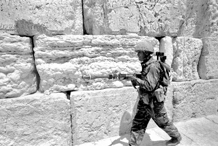 Israeli soldier walks in front of Western Wall in Jerusalem's Old City